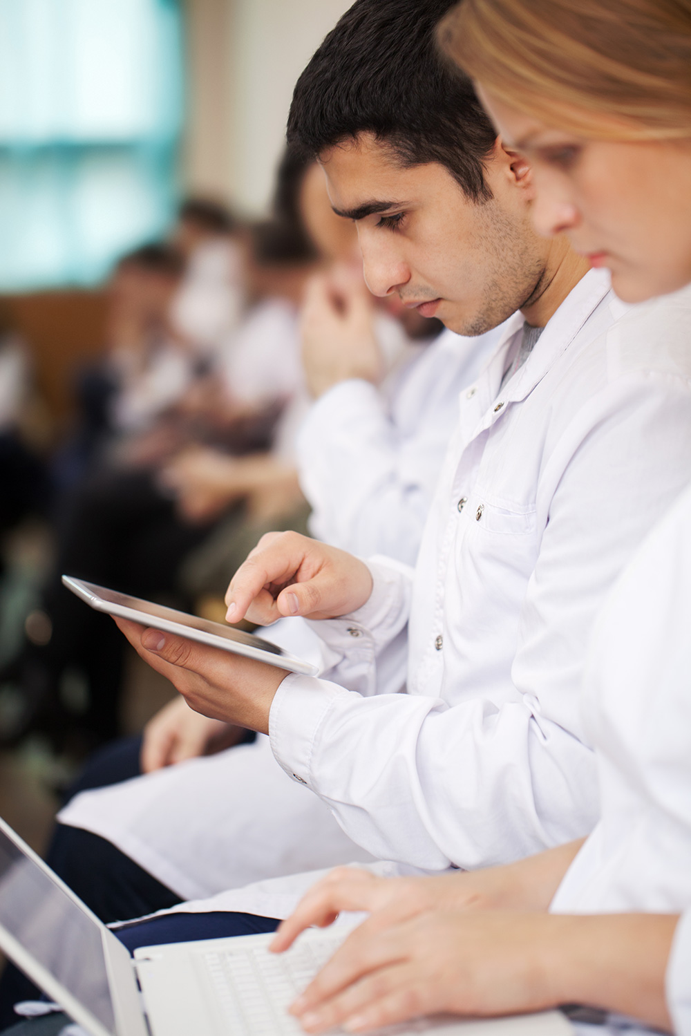 medical students with modern devices on the PJQC4Z9